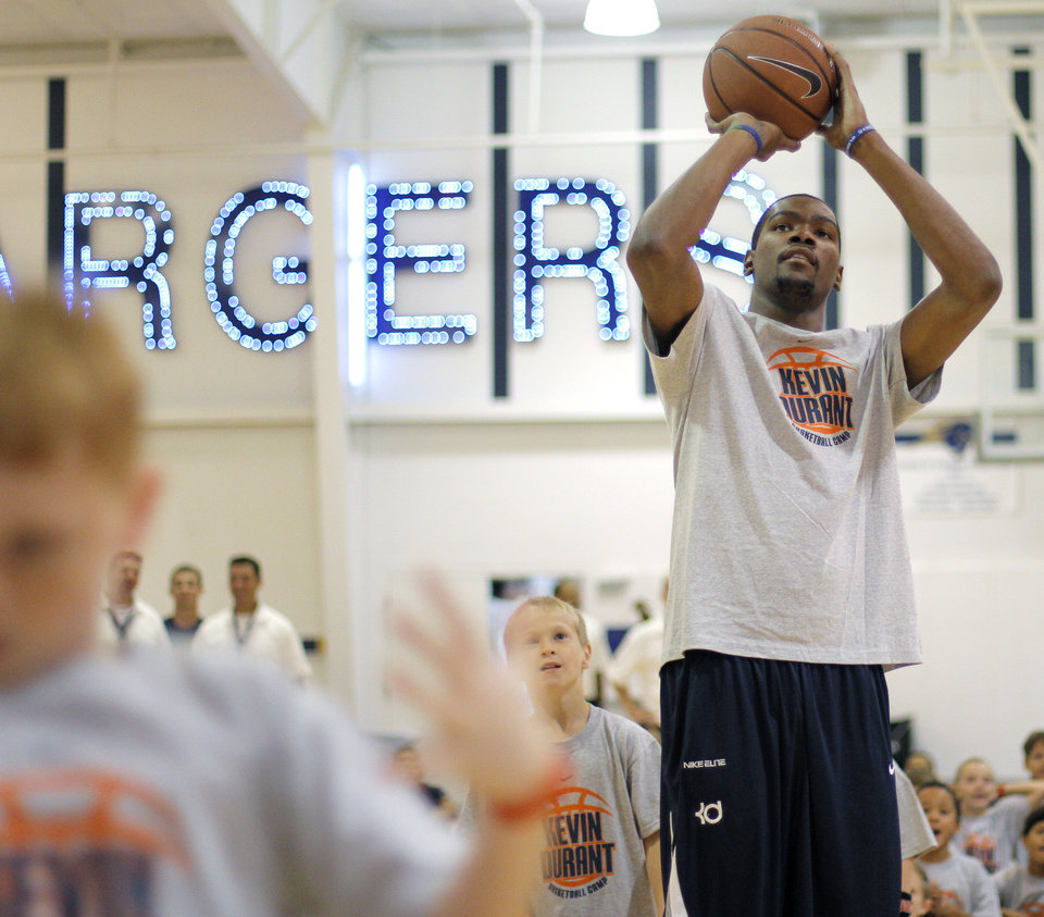 Photo - Kevin Durant participates in a shootout during the second day of the Kevin Durant basketball camp at Heritage Hall in Oklahoma City, Thursday, June 30, 2011.  Photo by Garett Fisbeck, The Oklahoman