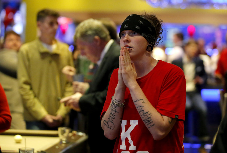 Photo - Dallas McManus of Wichita, Kan., watches election results as Republican Party backers gathered Tuesday night at Main Event Entertainment in northwest Oklahoma City as election returns rolled in the presidential race against Donald Trump and Democrat Hillary Clinton. Oklahomans on Tuesday also cast votes on several state ballot measures, a host of legislative contests and other local issues and offices. Photo by Bryan Terry, The Oklahoman