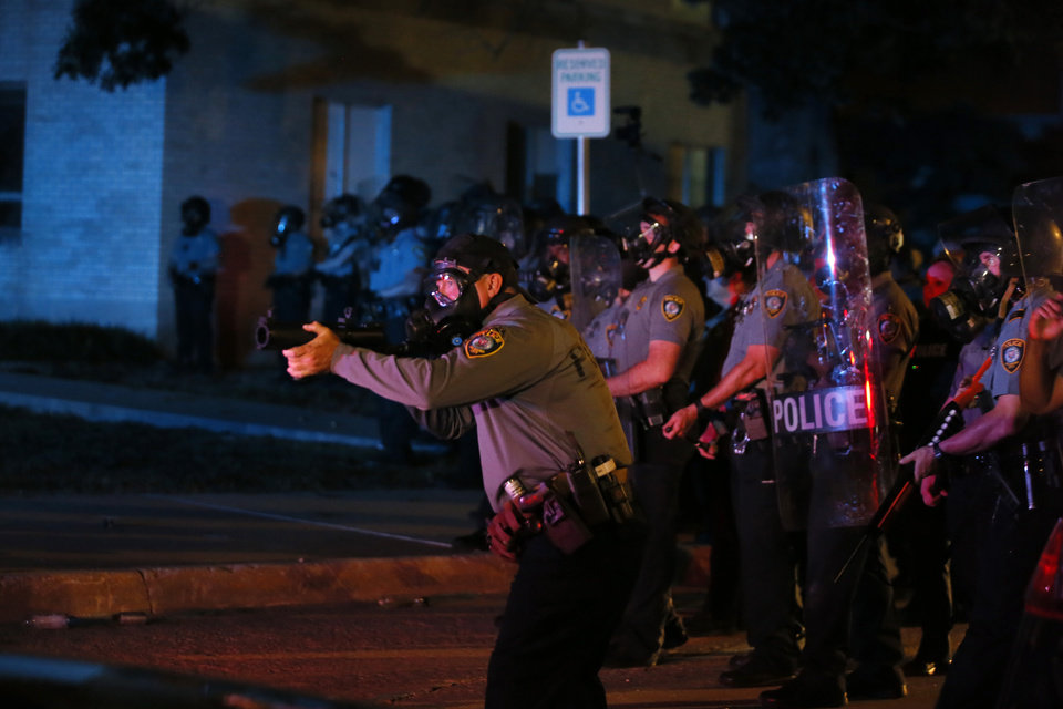 Photo - Police try to disperse protesters outside the Oklahoma City Police Department in Oklahoma City, Saturday, May 30, 2020. The protest was in response to the death of George Floyd. [Bryan Terry/The Oklahoman]