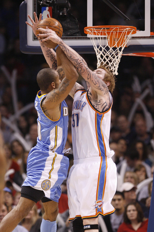 Robert Swift blocks a shot by Dahntay Jones in the first half as the Oklahoma City Thunder play the Denver Nuggets at the Ford Center in Oklahoma City, Okla. on Friday, January 2, 2009.  Photo by Steve Sisney/The Oklahoman