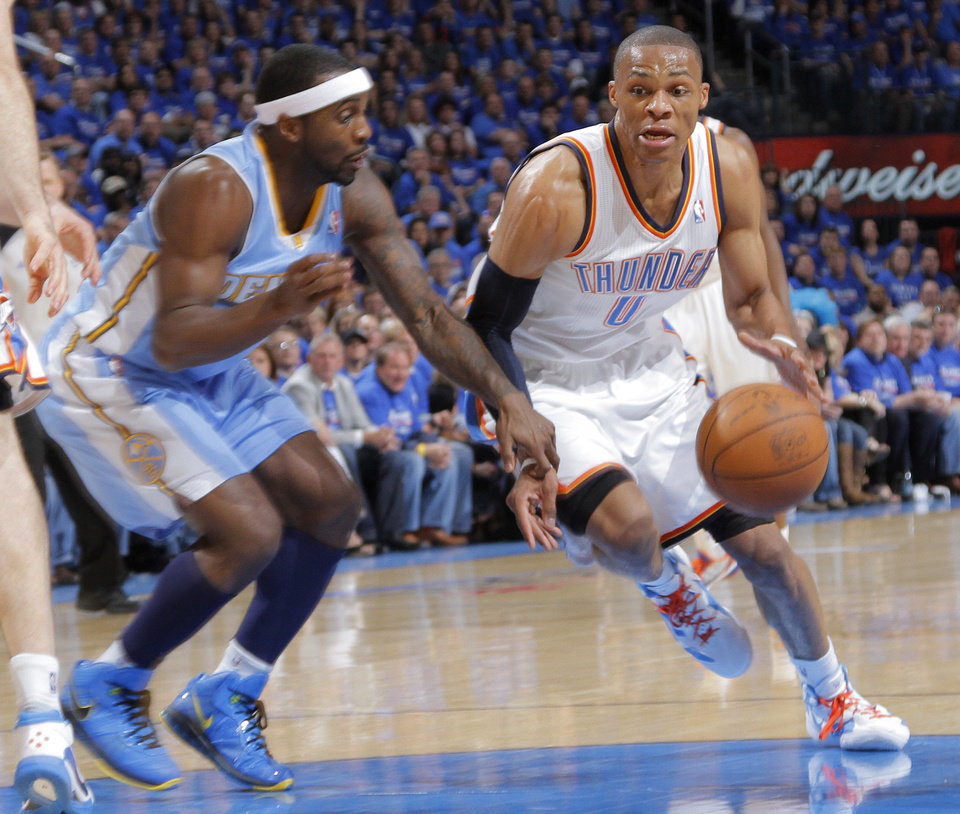 Photo - Oklahoma City's Russell Westbrook (0) drives past Denver's Kenyon Martin (4) during the first round NBA playoff game between the Oklahoma City Thunder and the Denver Nuggets on Sunday, April 17, 2011, in Oklahoma City, Okla. Photo by Chris Landsberger, The Oklahoman