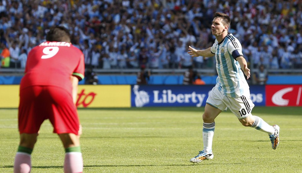 Photo - Argentina's Lionel Messi celebrates after scoring during the group F World Cup soccer match between Argentina and Iran at the Mineirao Stadium in Belo Horizonte, Brazil, Saturday, June 21, 2014. Argentina won 1-0.  (AP Photo/Jon Super)
