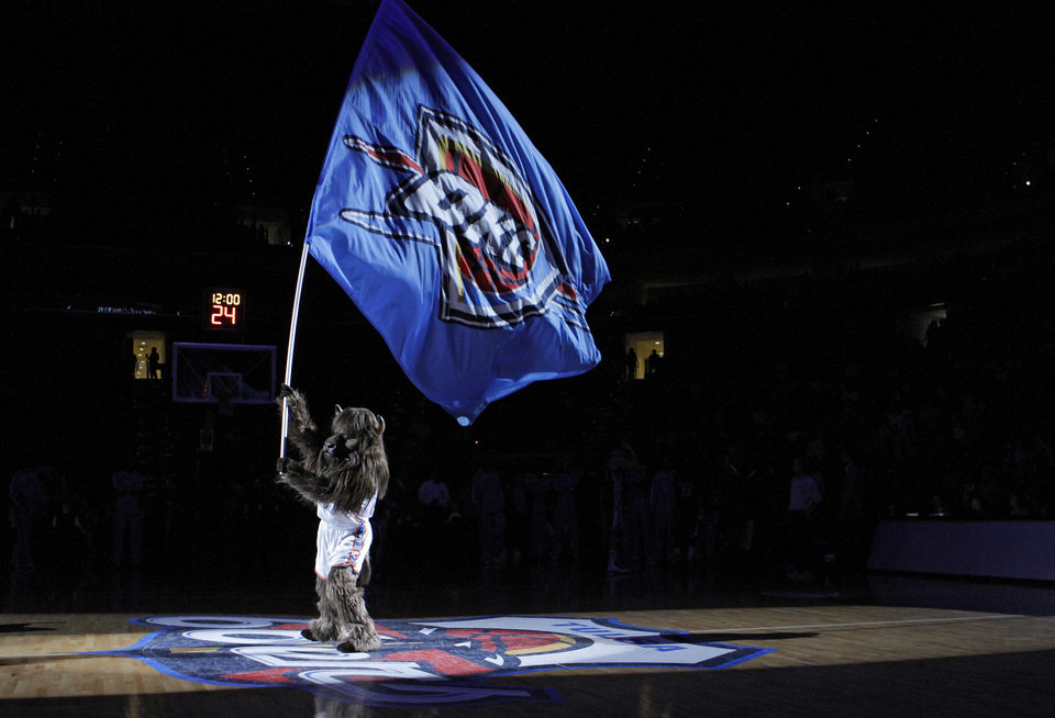 Rumble waves the Thunder flag before the start of the preseason NBA basketball game between the Oklahoma City Thunder and the Memphis Grizzlies on Tuesday, Oct. 12, 2010, in Tulsa, Okla.  Photo by Chris Landsberger, The Oklahoman