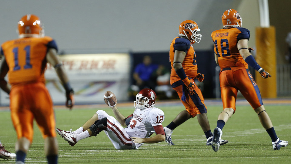 Photo - Oklahoma Sooners quarterback Landry Jones (12) hits the turf after a sack during the college football game between the University of Oklahoma Sooners (OU) and the University of Texas El Paso Miners (UTEP) at Sun Bowl Stadium on Sunday, Sept. 2, 2012, in El Paso, Tex.  Photo by Chris Landsberger, The Oklahoman