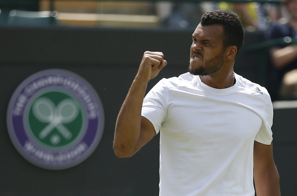Photo - Jo-Wilfried Tsonga of France celebrates winning against Juergen Melzer of Austria during their first round match at the All England Lawn Tennis Championships in Wimbledon, London,  Tuesday, June  24, 2014. (AP Photo/Pavel Golovkin)