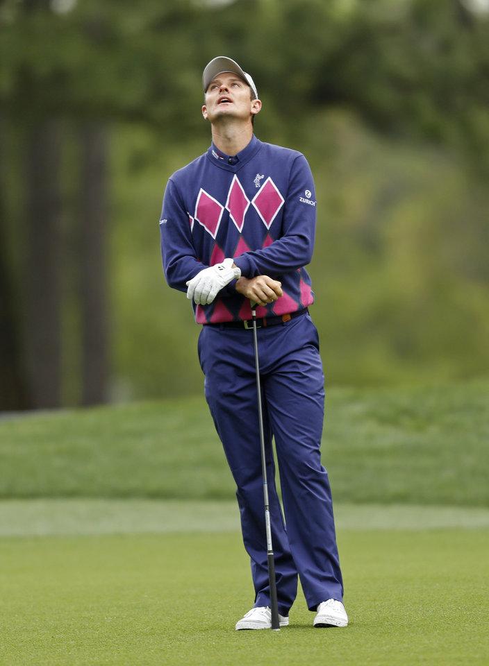 Photo - Justin Rose, of England, reacts after his approach shot on the 10th hole during the second round of the Wells Fargo Championship golf tournament in Charlotte, N.C., Friday, May 2, 2014. (AP Photo/Nell Redmond)