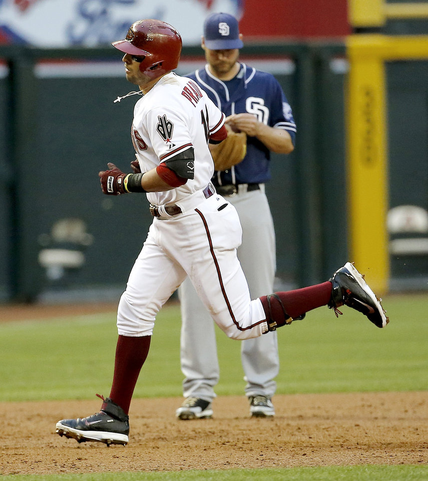Photo - Arizona Diamondbacks' Martin Prado rounds the bases after hitting a solo home run as San Diego Padres' Chase Headley looks away during the second inning of a baseball game, Tuesday, May 27, 2014, in Phoenix. (AP Photo/Matt York)