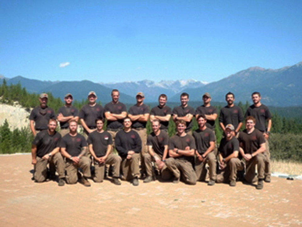 Photo - Unidentified members of the Granite Mountain Interagency Hotshot Crew from Prescott, Ariz., pose together in this undated photo provided by the City of Prescott. Some of the men in this photograph were among the 19 firefighters killed while battling an out-of-control wildfire near Yarnell, Ariz., on Sunday, June 30, 2013, according to Prescott Fire Chief Dan Fraijo. It was the nation's biggest loss of firefighters in a wildfire in 80 years. (AP Photo/City of Prescott)