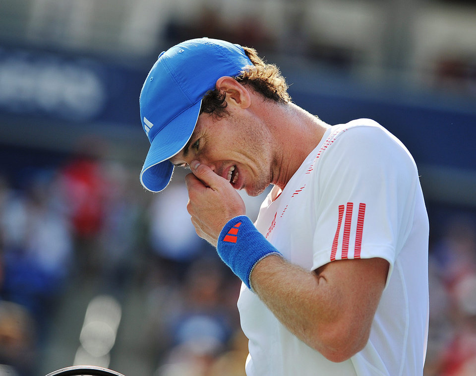 Andy Murray of Great Britain, reacts to a lost point against Flavio Cipolla of Italy, at the Rogers Cup men's tennis tournament in Toronto, Wednesday, Aug. 8, 2012. (AP Photo/The Canadian Press, Aaron Vincent Elkaim)