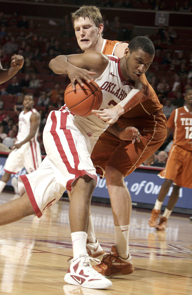 Oklahoma's Steven Pledger (2) drives to the basket as Texas' Clint Chapman (53)during the NCAA men's basketball game between the University of Oklahoma and Texas University at the Lloyd Noble Center in Norman, Okla., Tuesday, Feb. 14, 2012. Photo by Sarah Phipps, The Oklahoman