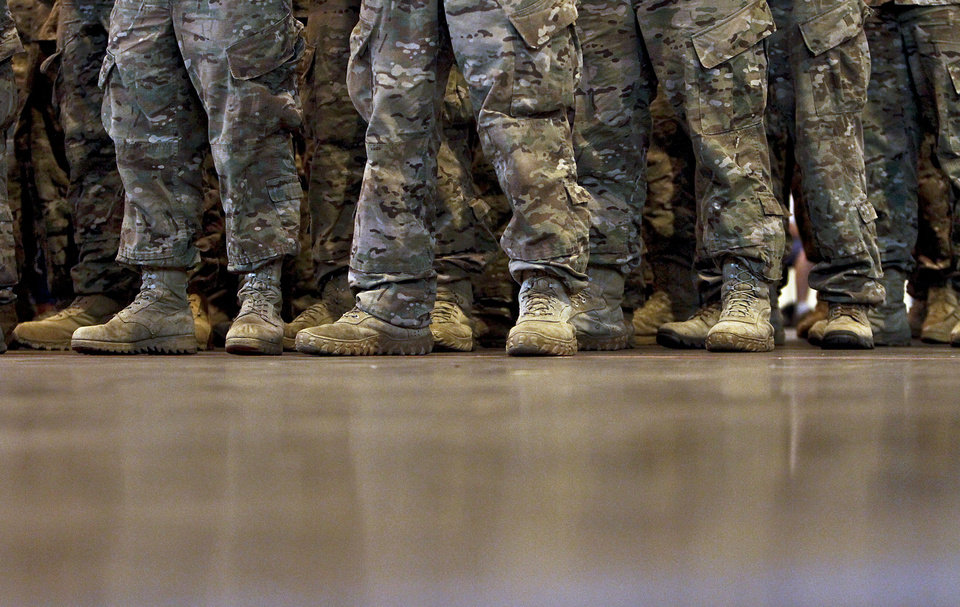 Soldiers stand in formation during the return ceremony for the National Guard's 45th Infantry Brigade Combat Team troops at the National Guard Base on Thursday, March 15, 2012, in Oklahoma City, Oklahoma.  Photo by Chris Landsberger, The Oklahoman