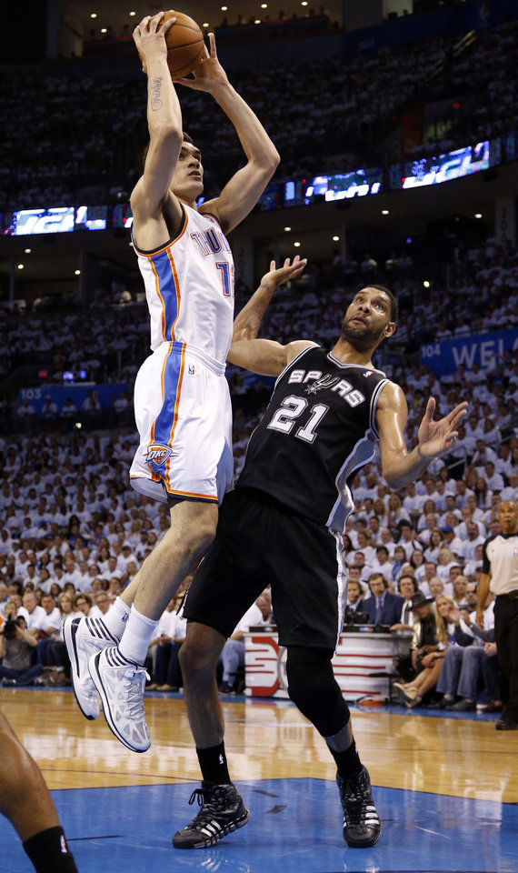 Photo - Oklahoma City's Steven Adams (12) goes to the basket in front of San Antonio's Tim Duncan (21) during Game 6 of the Western Conference Finals in the NBA playoffs between the Oklahoma City Thunder and the San Antonio Spurs at Chesapeake Energy Arena in Oklahoma City, Saturday, May 31, 2014. Photo by Bryan Terry, The Oklahoman
