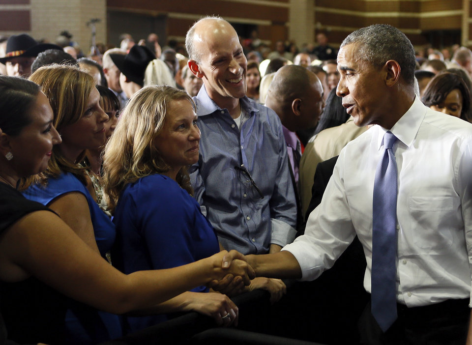 Photo - President Barack Obama shakes hands with people after giving a speech at Durant High School in Durant, Okla., Wednesday, July 15, 2015. Photo by Nate Billings, The Oklahoman