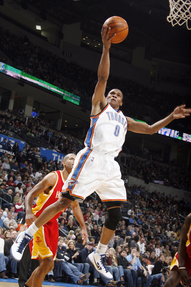 Photo - Russell Westbrook (0) shoots a layup during the NBA basketball game between the Oklahoma City Thunder and Houston Rockets, Sunday, Nov. 29, 2009, at  the Ford Center in Oklahoma City. Photo by Sarah Phipps, The Oklahoman ORG XMIT: KOD