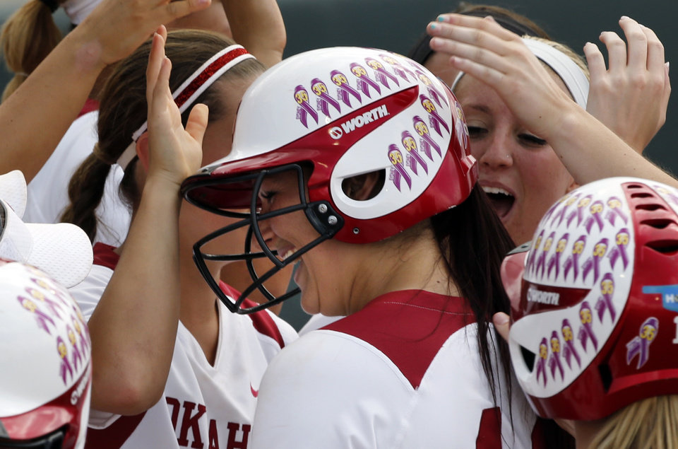 Photo - Teammates celebrate Lauren Chamberlain's second home run as the University of Oklahoma Sooner (OU) softball team plays Tennessee in game three of the NCAA super regional at Marita Hynes Field on May 25, 2014 in Norman, Okla. Photo by Steve Sisney, The Oklahoman