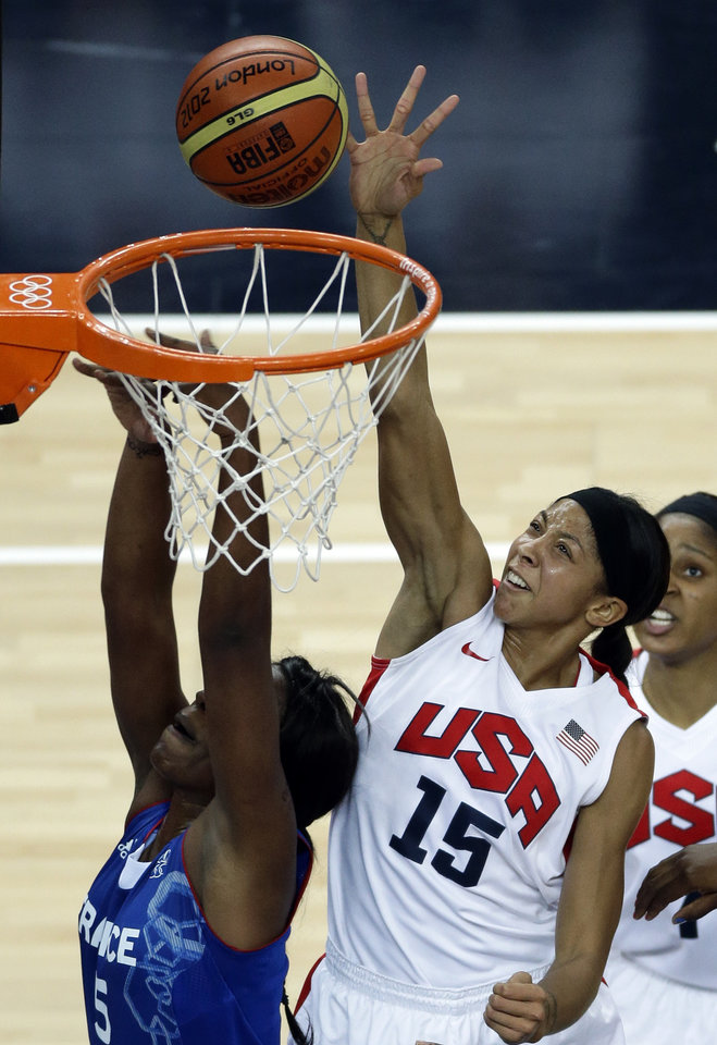 Photo -   United States' Candace Parker (15) shoots for the basket past France's Endene Miyem during a women's gold medal basketball game at the 2012 Summer Olympics, Saturday, Aug. 11, 2012, in London. (AP Photo/Victor R. Caivano)