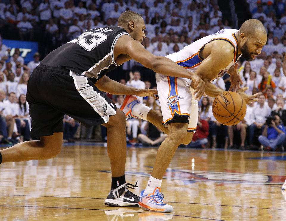 Photo - Oklahoma City's Derek Fisher (6) is fouled by San Antonio's Boris Diaw (33) during Game 6 of the Western Conference Finals in the NBA playoffs between the Oklahoma City Thunder and the San Antonio Spurs at Chesapeake Energy Arena in Oklahoma City, Saturday, May 31, 2014. Oklahoma City lost 112-107. Photo by Bryan Terry, The Oklahoman