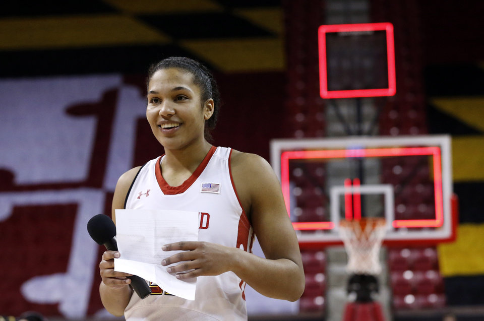 Photo - Maryland forward Alyssa Thomas acknowledges supporters during a ceremony to honor her after an NCAA college basketball game in College Park, Md., Sunday, March 2, 2014. Thomas contributed a game-high 20 points to Maryland's 87-48 win in her final home game as a Terrapin. (AP Photo/Patrick Semansky)