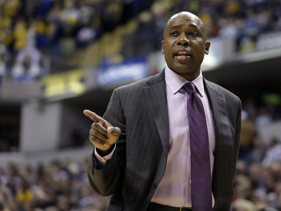 Photo - Orlando Magic head coach Jacque Vaughn questions an official as his team played the Indiana Pacers in the first half of an NBA basketball game in Indianapolis, Monday, Feb. 3, 2014. (AP Photo/Michael Conroy)