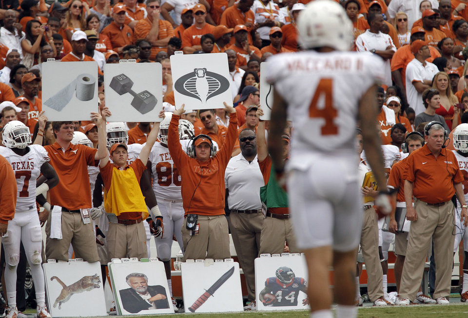 Photo - The Texas coaching staff calls in the plays during the Red River Rivalry college football game between the University of Oklahoma (OU) and the University of Texas (UT) at the Cotton Bowl in Dallas, Saturday, Oct. 13, 2012. Photo by Chris Landsberger, The Oklahoman