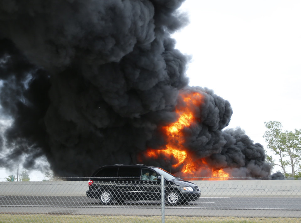 Photo - A massive fire on a northbound semi trailer loaded with roadway paint shut down Interstate 35 both north and southbound at around 6:45 p.m. on Wednesday, July 10, 2013 in Norman, Okla.  Photo by Steve Sisney, The Oklahoman