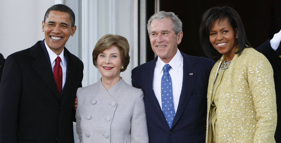 Photo - President Bush, center right, and first lady Laura Bush, center left, welcome President-elect Barack Obama, far left, and his wife Michelle Obama, right, on the North Portico of the White House in Washington, Tuesday, Jan. 20, 2009. (AP Photo/Pablo Martinez Monsivais)