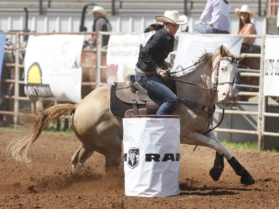 Photo - Laramie Girty, from Porum, OK, competes in the Barrel Racing event during Tuesday's performances at the International Youth Finals Rodeo at the Shawnee Heart of Oklahoma Exposition Center in Shawnee, OK, Tuesday, July 8, 2014,  Photo by Paul Hellstern, The Oklahoman