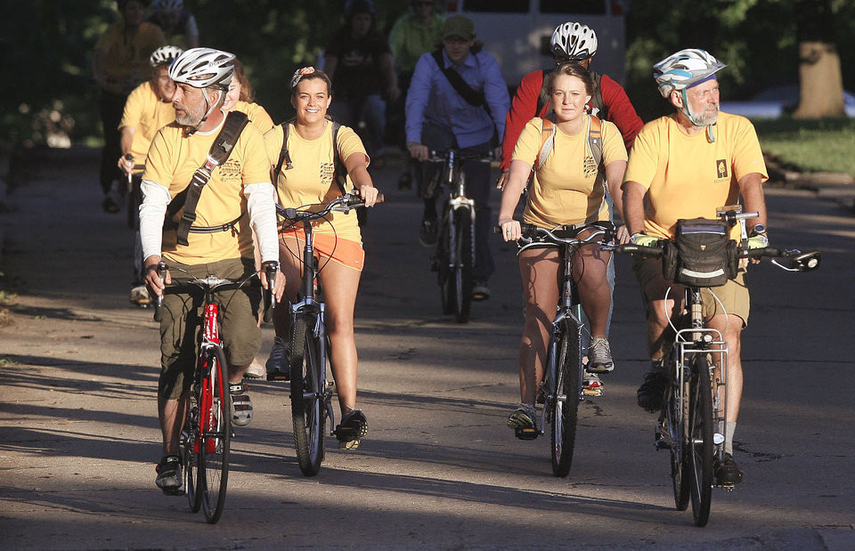 Photo - Edmond Memorial High School students, teachers and bicycle enthusiasts participate in Edmond's first Bike to School Day. PHOTO BY PAUL HELLSTERN, THE OKLAHOMAN