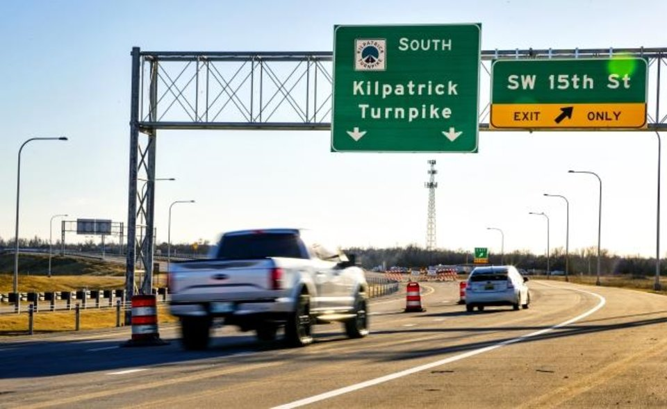 Photo -  Motorists  who want to go south on the new  Southwest Extension of the John Kilpatrick Turnpike in Oklahoma City will have to wait a couple weeks. However, the new turnpike will open to northbound/westbound traffic on Thursday. [Chris Landsberger/The Oklahoman]