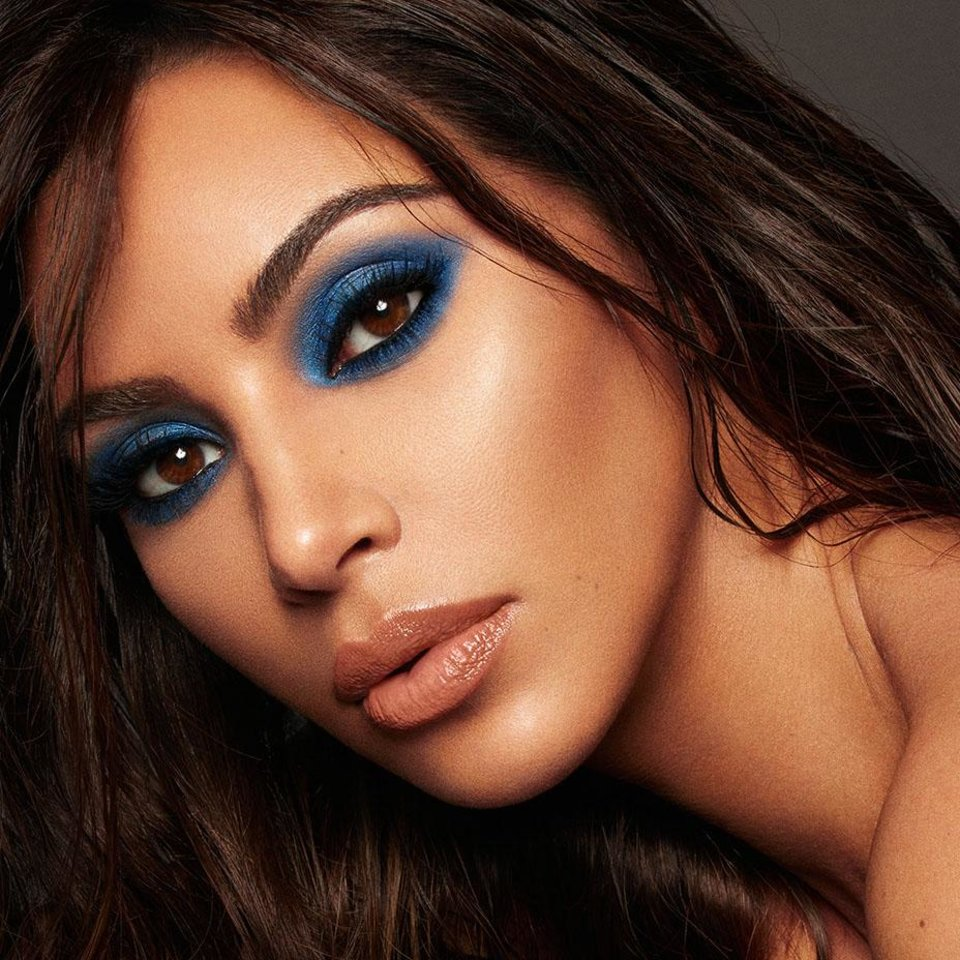 Photo - Kim Kardashian wears cobalt blue eye shadow, one of the colors in her new KKW x Mario beauty collaboration.