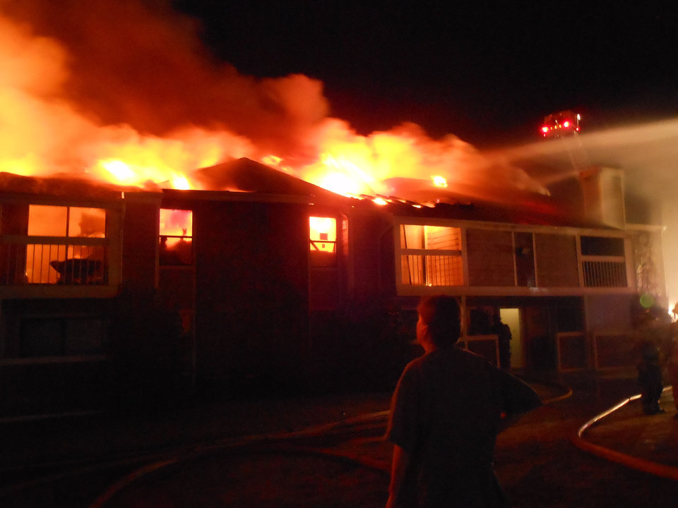 Photo - An apartment fire Sunday morning at Raindance Apartments, near NW 122 and N Pennsylvania Avenue in Oklahoma City, destroyed 16 units, fire officials said. Story, Page 5APhoto by Silas Allen, The oklahoman