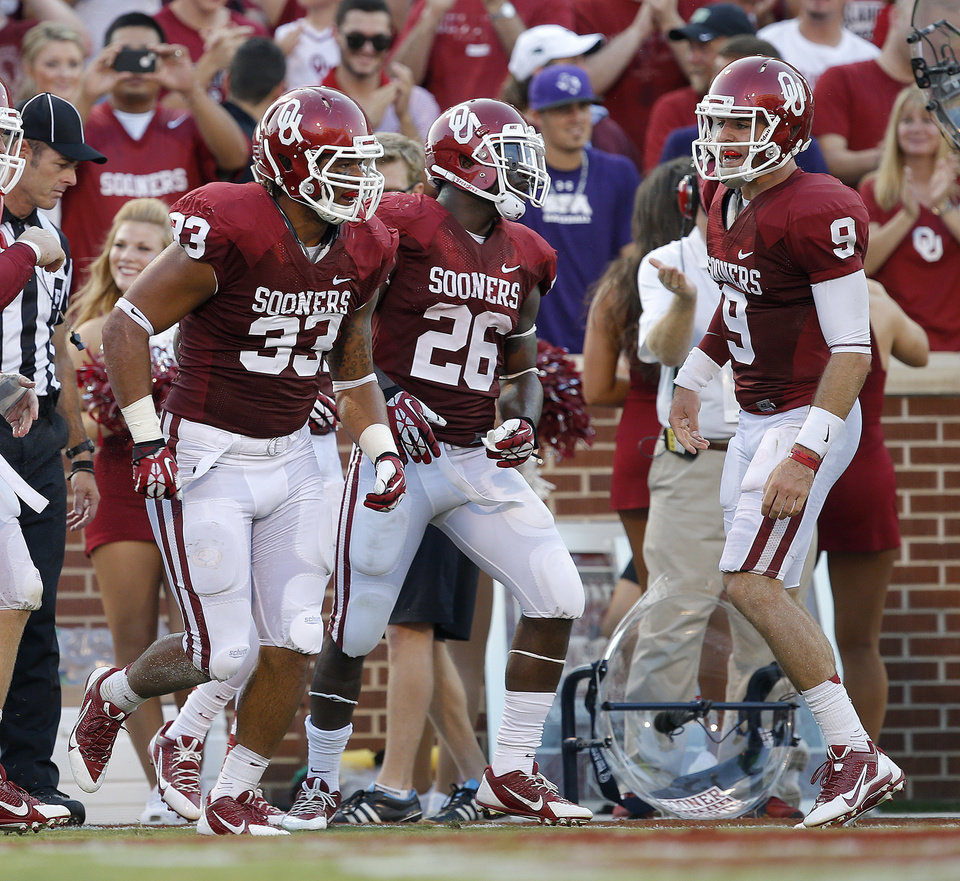 Oklahoma's Trey Millard (33) celebrates with David Smith (25), and Trevor Knight (9) after scoring a touchdown during a college football game between the University of Oklahoma Sooners (OU) and the West Virginia University Mountaineers at Gaylord Family-Oklahoma Memorial Stadium in Norman, Okla., on Saturday, Sept. 7, 2013. Oklahoma won 16-7. Photo by Bryan Terry, The Oklahoman