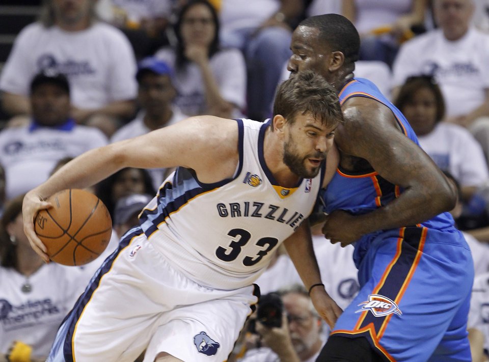 Memphis Grizzlies center Marc Gasol (33), of Spain, drives against Oklahoma City Thunder center Kendrick Perkins during the first half of Game 6 of a second-round NBA basketball playoff series on Friday, May 13, 2011, in Memphis, Tenn. (AP Photo/Lance Murphey)