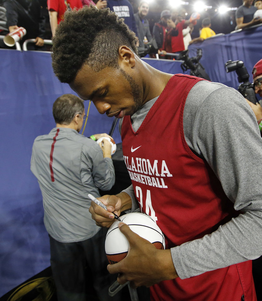 Photo - Oklahoma's Buddy Hield (24) and coach Lon Kruger sign autographs after practice on Final Four Friday before the national semifinal between the Oklahoma Sooners and the Villanova Wildcats in the NCAA Men's Basketball Championship at NRG Stadium in Houston, Friday, April 1, 2016. OU will play Villanova in the Final Four on Saturday. Photo by Nate Billings, The Oklahoman