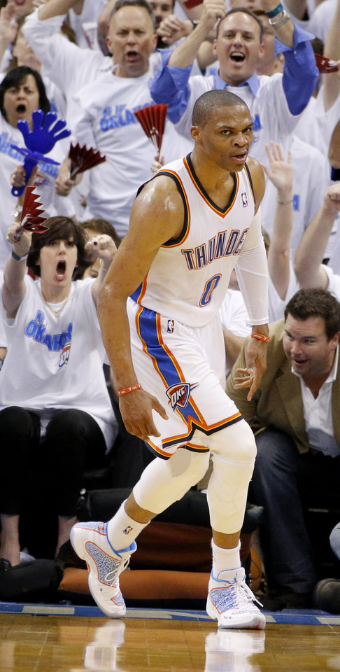 Photo - Russell Westbrook (0) reacts after a slam dunk in the third quarter during Game 2 of the Western Conference semifinals in the NBA playoffs between the Oklahoma City Thunder and the Los Angeles Clippers at Chesapeake Energy Arena in Oklahoma City, Wednesday, May 7, 2014. Photo by Bryan Terry, The Oklahoman