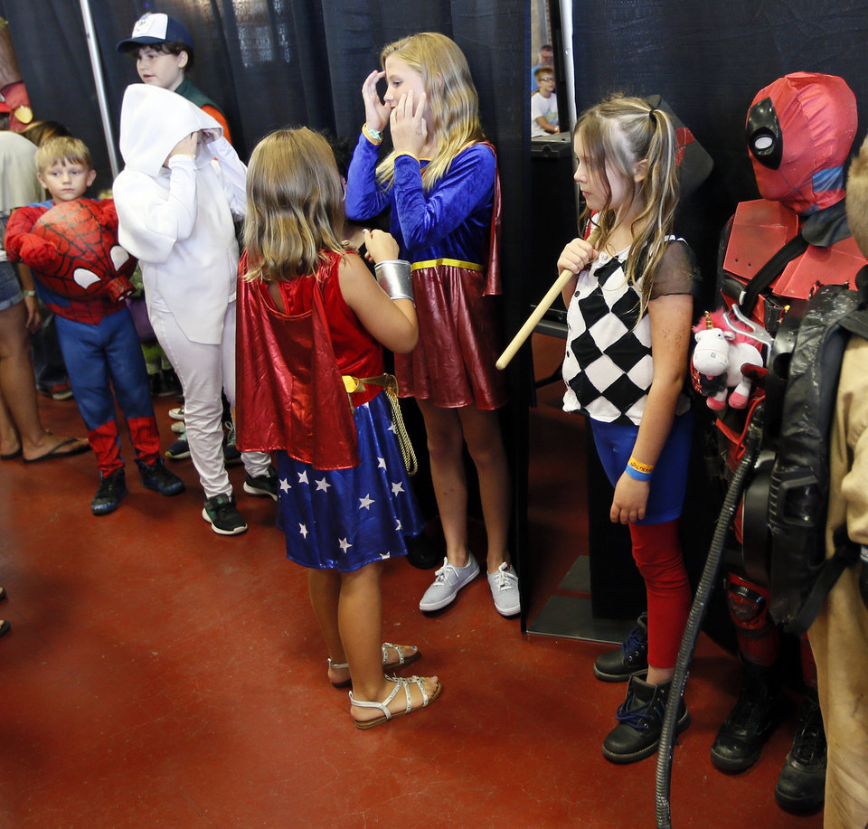 Photo - Children wait to compete in the costume contest during New World Comic Con in the Centennial Building at State Fair Park in Oklahoma City, Saturday, July 29, 2017. Photo by Nate Billings, The Oklahoman