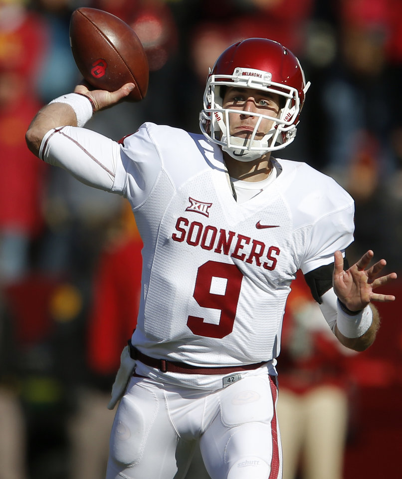 Photo - Oklahoma's Trevor Knight (9) throws a pass during a college football game between the University of Oklahoma Sooners (OU) and the Iowa State Cyclones (ISU) at Jack Trice Stadium in Ames, Iowa, Saturday, Nov. 1, 2014. Photo by Bryan Terry, The Oklahoman