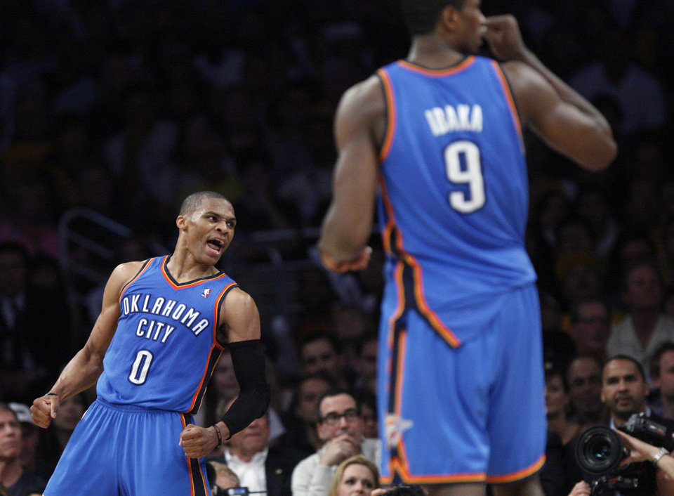 Oklahoma City\'s Russell Westbrook (0) and Serge Ibaka (9) celebrate during Game 4 in the second round of the NBA basketball playoffs between the L.A. Lakers and the Oklahoma City Thunder at the Staples Center in Los Angeles, Saturday, May 19, 2012. Photo by Nate Billings, The Oklahoman