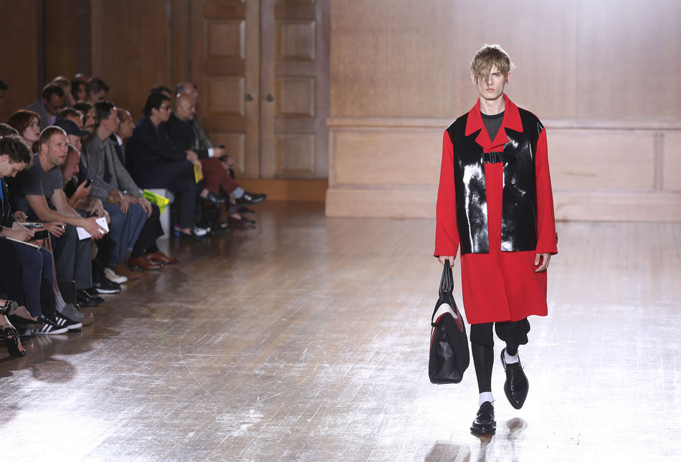 Photo - A model wears a creation by Alexander McQueen during London Men's spring summer fashion collections 2015, at the Royal College of Surgeons of England by Lincoln's Inn Fields, central London, Monday, June 16, 2014. (Photo by Joel Ryan/Invision/AP)