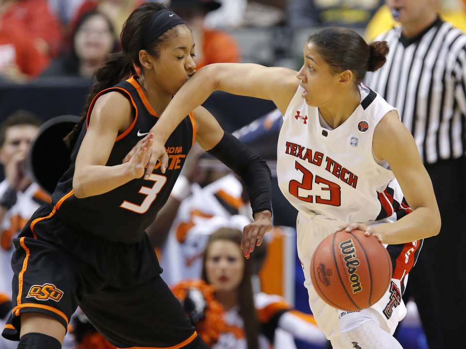 Photo - Oklahoma State's Tiffany Bias (3) gets hit by Texas Tech's Monique Smalls (23) during the Big 12 tournament women's college basketball game between Oklahoma State University and Texas Tech University at American Airlines Arena in Dallas, Saturday, March 9, 2012. Oklahoma State won 59-54.  Photo by Bryan Terry, The Oklahoman