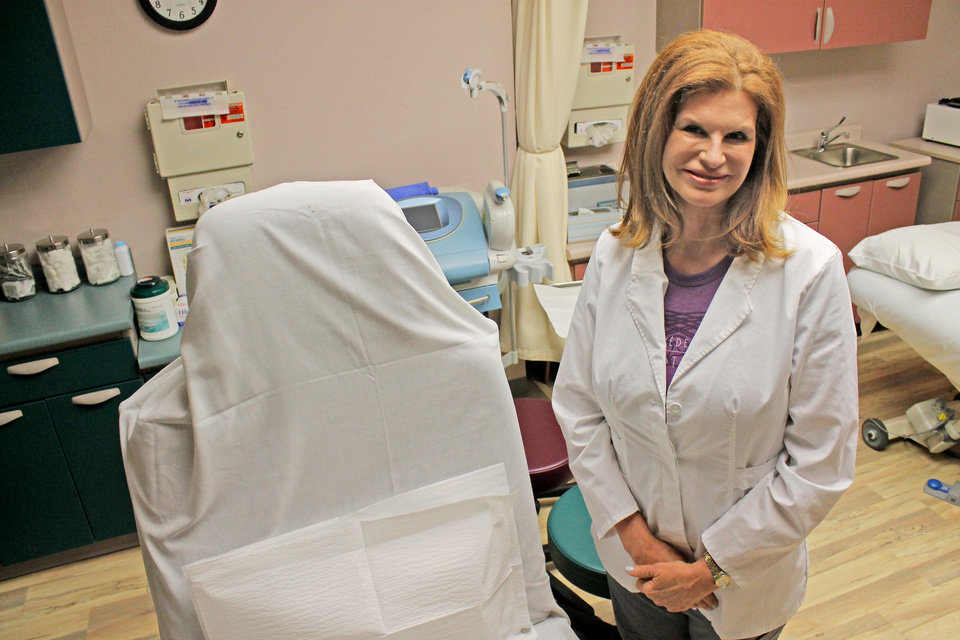 Photo - Dr. Joan Hardt, a cosmetic surgeon and full-time medical director at Rejuvena Cosmetic Medical Center, perform Botox injections at her Oklahoma City clinic. Botox injections can have both medical and cosmetic benefits.  Jaclyn Cosgrove