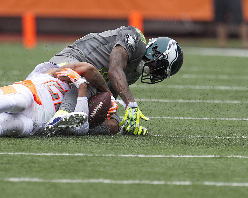Photo - Philadelphia Eagles Desean Jackson (10), of Team Sanders, has the ball stripped from him by Cleveland Browns cornerback Joe Haden (23), of Team Rice, during the second quarter at the NFL Pro Bowl football game at Aloha Stadium, Sunday. Jan. 26, 2014, in Honolulu. (AP Photo/Marco Garcia)