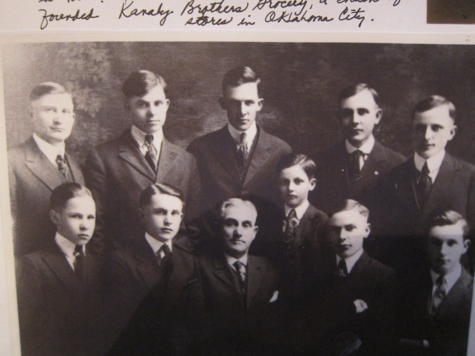 Photo -  In this vintage photo, Kathleen O'Meara Marks' great-grandfather Matthew Kanaly, bottom row, third from left, poses for a picture with 10 of his 11 sons, including Marks' grandfather Edwin, pictured top left. Photo provided