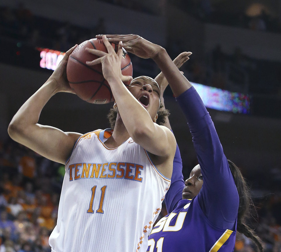 Photo - Tennessee forward Cierra Burdick (11) has her shot blocked by LSU forward Shanece McKinney (21) during the first half in an NCAA college basketball game in the quarterfinals of the Southeastern Conference women's tournament, Friday, March 7, 2014, in Duluth, Ga. (AP Photo/Jason Getz)