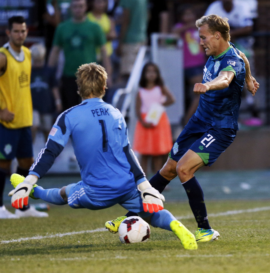 Photo - Oklahoma City's Steven Perry (21) tries to get the ball past LA goalkeeper Brian Perk (1) during a soccer game between the OKC Energy FC and LA Galaxy II at Pribil Stadium at Bishop McGuinness Catholic High School in Oklahoma City, Saturday, Aug. 16, 2014. Photo by Nate Billings, The Oklahoman