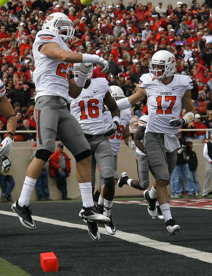 Photo - Oklahoma State's Zack Craig (23) celebrates a Cowboys fumble recovery on a kick off during a college football game between Texas Tech University (TTU) and Oklahoma State University (OSU) at Jones AT&T Stadium in Lubbock, Texas, Saturday, Nov. 12, 2011.  Photo by Sarah Phipps, The Oklahoman  ORG XMIT: KOD