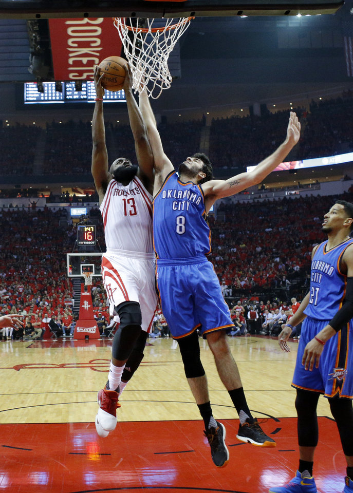 Photo -  Oklahoma City's Alex Abrines tires to defend a shot by Houston's James Harden during the NBA playoffs in April. Abrines is getting ready to play in a tournament in Europe. [PHOTO BY SARAH PHIPPS, THE OKLAHOMAN]