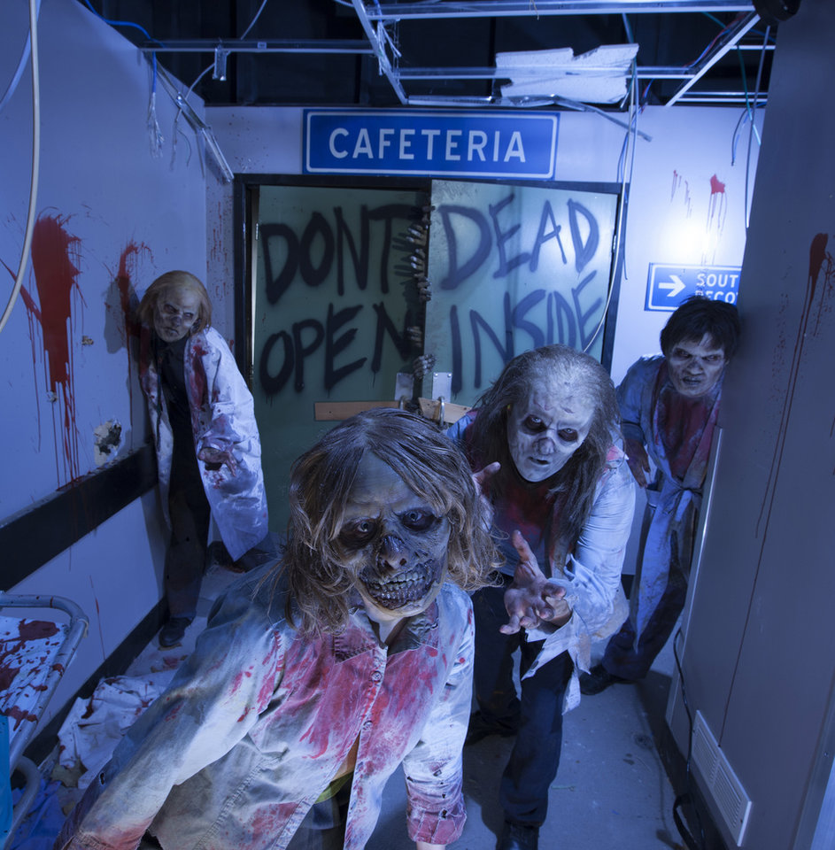 "Photo -   This image provided by Universal Orlando Resort shows actors portraying zombies at an attraction themed on the AMC show ""The Walking Dead"" at Universal's Halloween Horror Nights in Orlando, Fla. The theme park also has attractions inspired by the video game and movie ""Silent Hill,"" Alice Cooper's concept album ""Welcome to My Nightmare"" and a House of Horrors featuring classic monsters from Universal films. (AP Photo/Universal Orlando Resort, Kevin Kolczynski)"