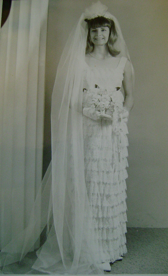 Photo - Nancy Wade Kerr spotted her dress in an advertisement in the '60s and knew it was her dream dress, she said. Each row of lace was handstitched by a seamstress in Duncan. A fun fact about Kerr's Aug. 6, 1966, wedding is that she watched President Lyndon Johnson's daughter's wedding while she got ready for her own, she said. Photo provided by Nancy Kerr.  PROVIDED