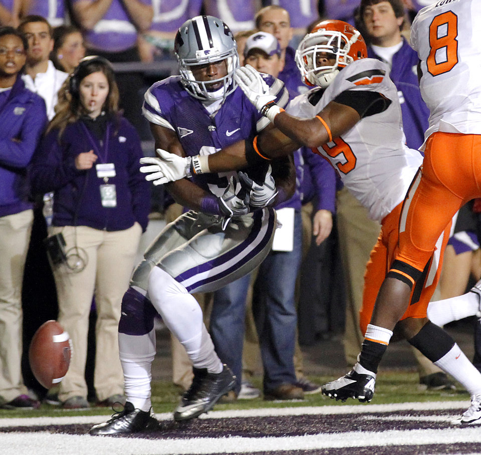 Photo - Oklahoma State's Brodrick Brown (19) breaks up a pass for Kansas State's Chris Harper (3) during the college football game between the Oklahoma State University Cowboys (OSU) and the Kansas State University Wildcats (KSU) at Bill Snyder Family Football Stadium on Saturday, Nov. 1, 2012, in Manhattan, Kan. Photo by Chris Landsberger, The Oklahoman